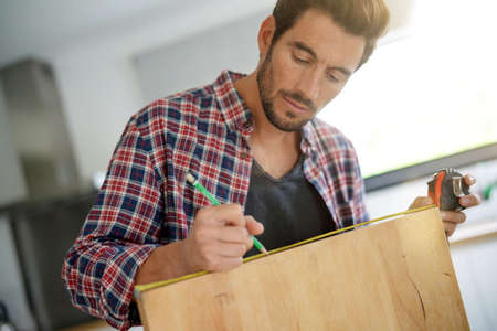 Middle-aged guy doing do-it-yourself works at home