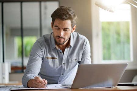 Modern man working in office