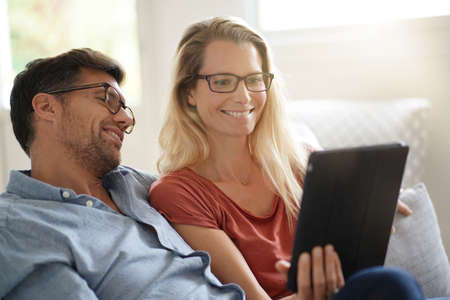 Young couple watching movie on digital tablet