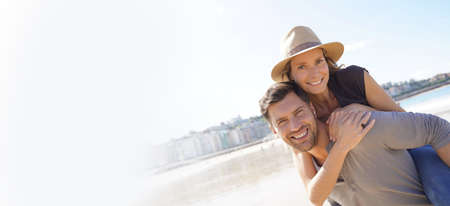 Middle-aged couple having fun at the beach Banco de Imagens
