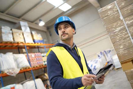 Warehouseman controlling incoming goods