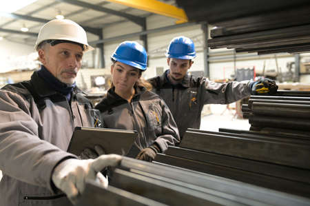 Steelwork instructor with young apprentice in workshop Imagens