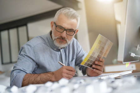 Home designer working in office on desktop Reklamní fotografie