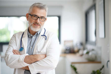 Portrait of mature doctor with eyeglasses