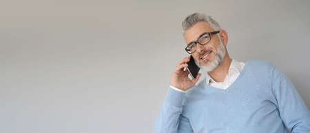 Portrait of middle-aged man using smartphone, template