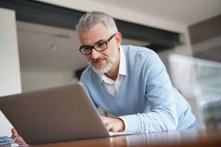 Man in office working on laptop computer Reklamní fotografie