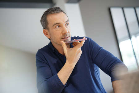 Portrait of middle-aged man talking on smartphone