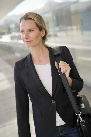 Executive woman going to attend business convention Standard-Bild