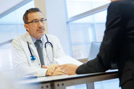 Specialist with patient in doctor's office