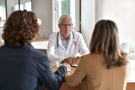 Young couple having an appointment at the doctor's office
