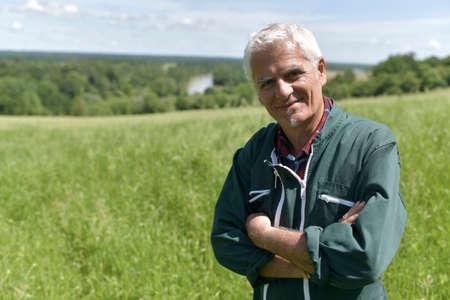 Farmer standing in green field