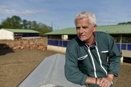 Portrait of farmer in poultry yard