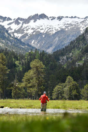 fly fisherman in the high mountains