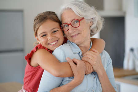 Portrait of smiling grandmother with grandkid