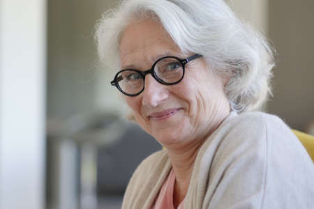 Smiling senior woman with eyeglasses 스톡 콘텐츠