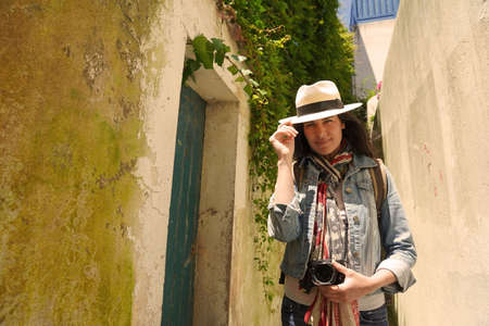 Tourist woman walking in narrow streets of small town 스톡 콘텐츠 - 151479821