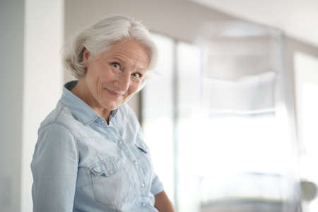 Portrait of smiling senior woman with white hair 스톡 콘텐츠 - 151472467