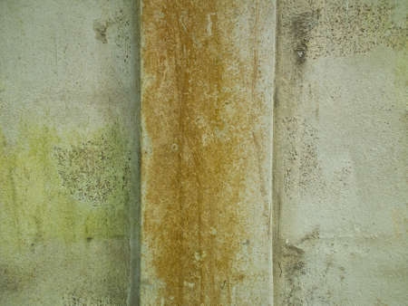 this is old wall have a pole at center area Stock Photo