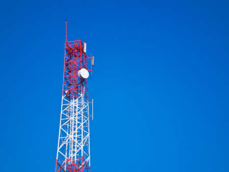 This is Mast or monopole  on blue sky background photo