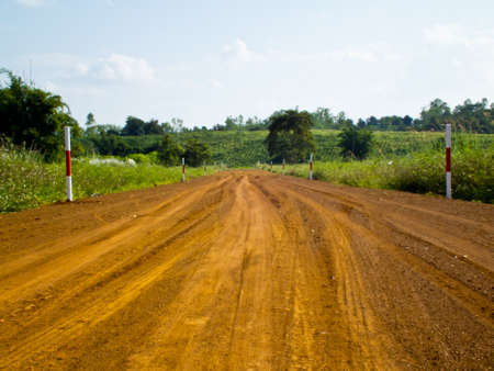 This is road to farm in daylight Stock Photo