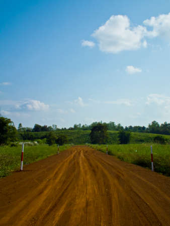 This is road to farm and blue sky background Stock Photo - 11270273