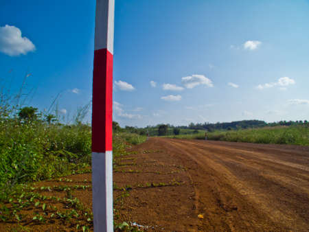this is pole inside road  is way to farm Stock Photo - 11270298