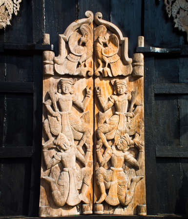 this is a wooden carving door Its have a brown and black colours