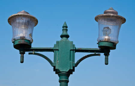 This is a old light pole body of pole have a green colour photo