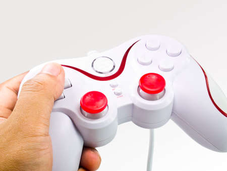 This is a joystick in the hand on gradient tone background Stock Photo