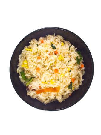 huevos fritos: Se trata de un arroz frito Bowl negro Foto de archivo