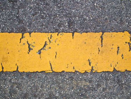 This is a line sign on asphalt road have a broken photo