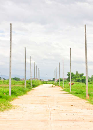 This is a deserted way ,in side way have a pole Stock Photo - 14291522