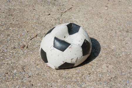 Its a Old soccer ball on concrete