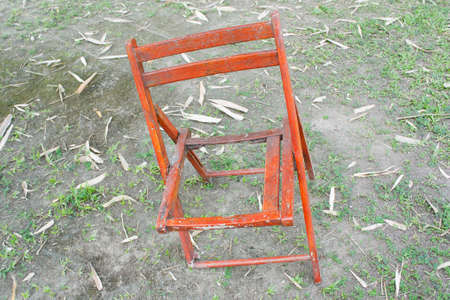 broken chair on ground and glass