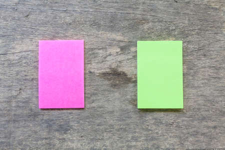 pink and green reminder sticky note on wood plate