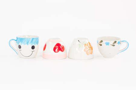 paraphernalia: ceramic cuties cups on white background