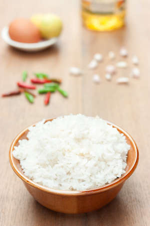 cooked rice with chilli garlic egg and oil on wood table, its an ingredient for cooking
