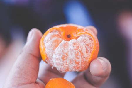 hand hold orange add smooth tone effect