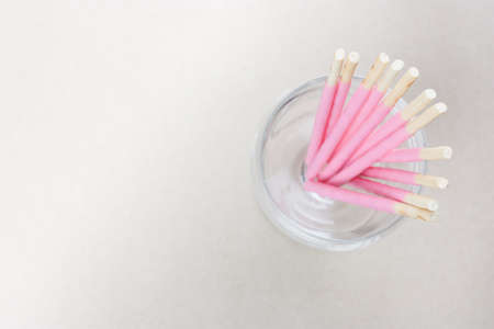 pink biscuits sticks in glass, its a sweet snack in top view and copy space