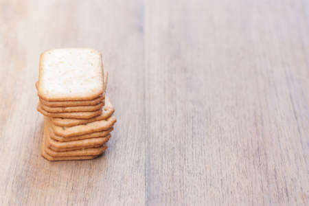 stacking biscuits place on left side of wood table