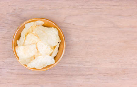 potato chips on bowl with copy space on right side