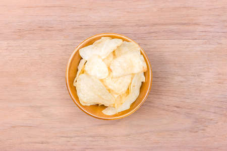 potato chips bowl on center of wood table  with copy space