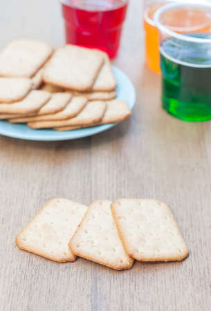biscuits stacking and copy space , have a sparkling water glass and snack in background Stock Photo