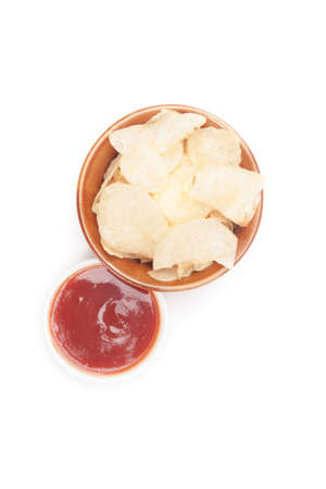 potato chips on bowl and catchup place on center of white background Stock Photo