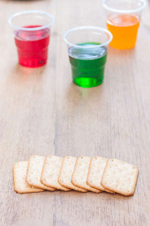 sparkling water: biscuits stacking and sparkling water on background Stock Photo