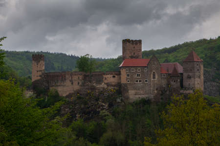 castle buildings: Austria. Ancient castle Riegersburg in the forested mountains in the rain