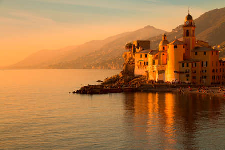 sea of houses: Italy. Camogli town. Mediterranean sea. Views of mountains, sea, beach and town clock. Beautiful colored sunset Stock Photo