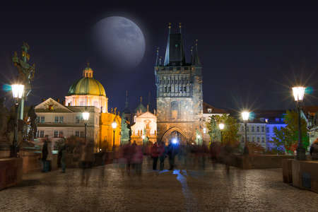 charles bridge: Czech Republic. Prague. Night on the Charles bridge and the moon. Many unrecognizable people