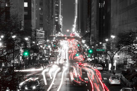 42nd: USA. Night NYC. Traffic at the intersection of 42nd street and 2nd Ave. Black and White Stock Photo