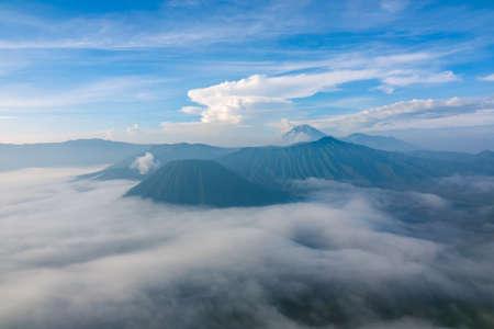 Indonesia. Morning in the Bromo Tengger Semeru National Park. Dense fog in the valley